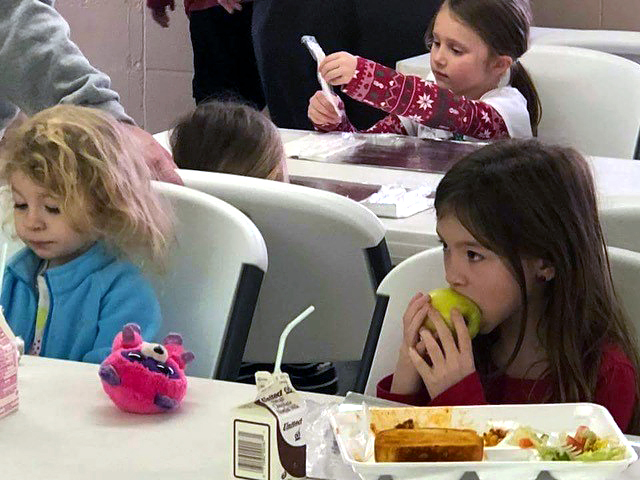 Children enjoy a hot lunch at West Milford United Methodist Church.  The church also delivered meals to children out in the community.  The meals were prepared by an ecumenical group that included teachers, school staff and members of the church. Photo courtesy of the Rev. Deborah Coble, West Virginia Conference.
