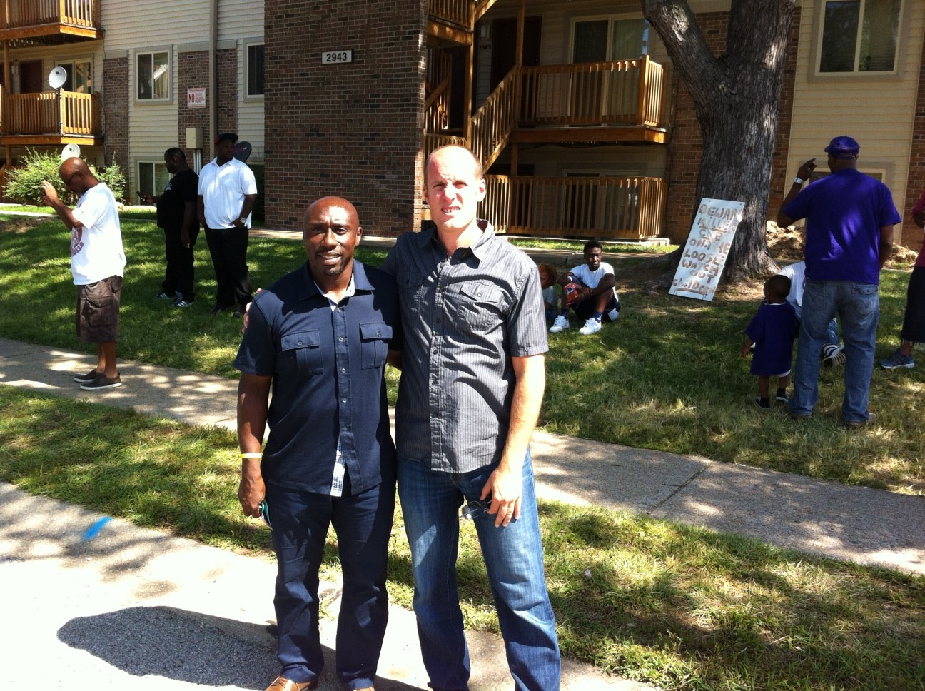 The Rev. Willis Johnson (left) and the Rev. Matt Miofsky stand near the site where Michael Brown was killed in August, 2014.
