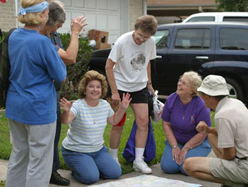 The Rev. Marilyn Roeder, center in stripped shirt, has brought mission teams from Victoria, Texas, to New Orleans 11 times since Hurricane Katrina struck. A UMNS photo by Kathy Gilbert.