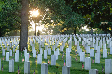 At Arlington (Va.) National Cemetary, flags decorate the tombs of those who died in the service of their country. Photo courtesy of Arlington National Cemetery.