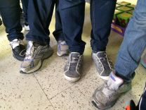 Young people from Central America wear shoes without laces. Photo courtesy Viky Garcia, Laredo Humanitarian Relief Team.