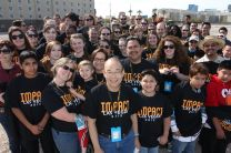 Bishop Robert T. Hoshibata poses with the Impact Las Vegas 2013 volunteers following the morning cleaning a neighborhood off Palos Verdes.