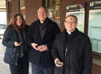 Clergy in Maplewood, New Jersey share signs of faith with commuters at a train station on Ash Wednesday 2014.  Photo courtesy of the Rev. Chris Heckert.