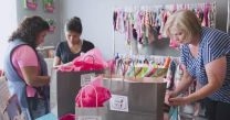 Young mother shops at the Berry Sweet Babies boutique run by University United Methodist Church.