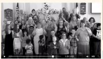 Video image shows members of Rose (NY) United Methodist Church appearing in a music video for Reba McEntire's song