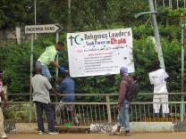 Ebola banner in Sierra Leone. Photo by Phileas Jusu, UMNS