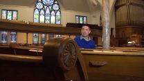 Hispanic man sits in church pew in Michigan. Courtesy: United Media Creations.