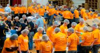 Volunteers in Hagerstown, Ind. assemble 155,520 one-pound food packets to feed the hungry. Photo by Daniel R. Gangler.