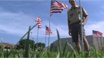 Video image of Scouts at St. Mark's UMC in Lincoln, Nebraska as they plant flags for July 4th.
