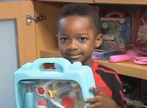 A boy receives a toy at an Atlanta pediatric hospital through the charity created in memory of Joey Doolittle who passed away at age 9.