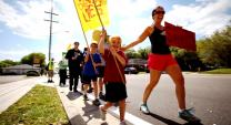 Emily Hutchings and her children take part in a protest about conditions for farm workers in Lakeland, FL. Hutchings is an active member of United Methodist Women.  Image courtesy of videographer Clay Kisker.