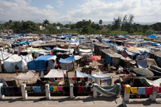 More than 5,000 Haitians live in the makeshift camp at Leogane's municipal soccer stadium.