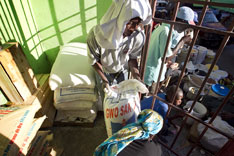 Workers move bags of flour in the Boutique Market in Port-au-Prince,Haiti, where the United Methodist Committee on Relief is buying supplies to feed 160 families in Mellier.