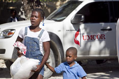 Recipients leave an UMCOR aid distribution in Mellier, Haiti.