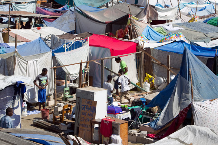 Families crowd a makeshift camp at the municipal soccer stadium in Leogane, Haiti, following the earthquake.