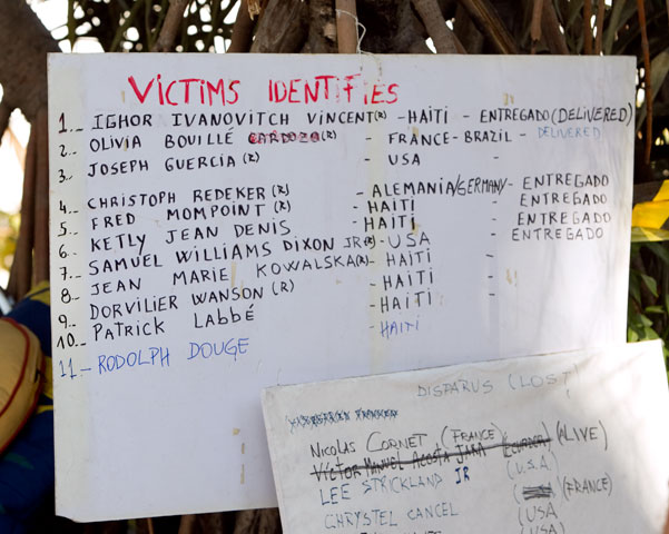 Hand-lettered signs list those killed or trapped at the Hotel Montana. A UMNS photo by Mike DuBose.