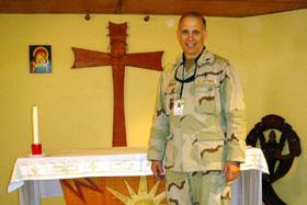 The Rev. Dan Nigolian in a field chapel in Afghanistan.