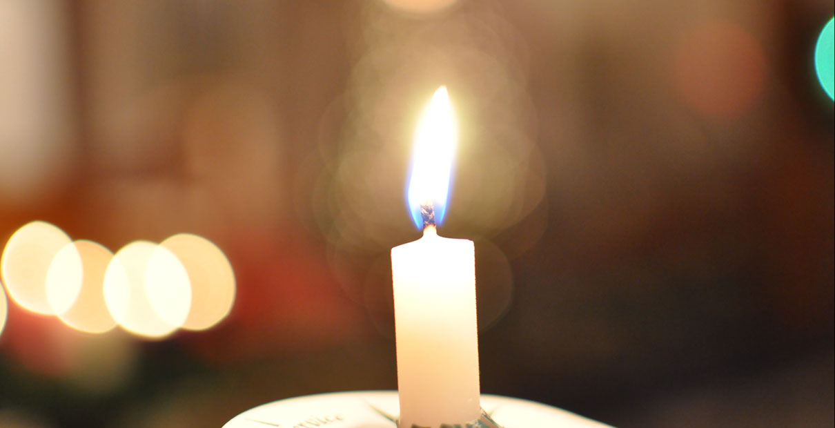 Candle from a Candlelight Christmas Eve service.