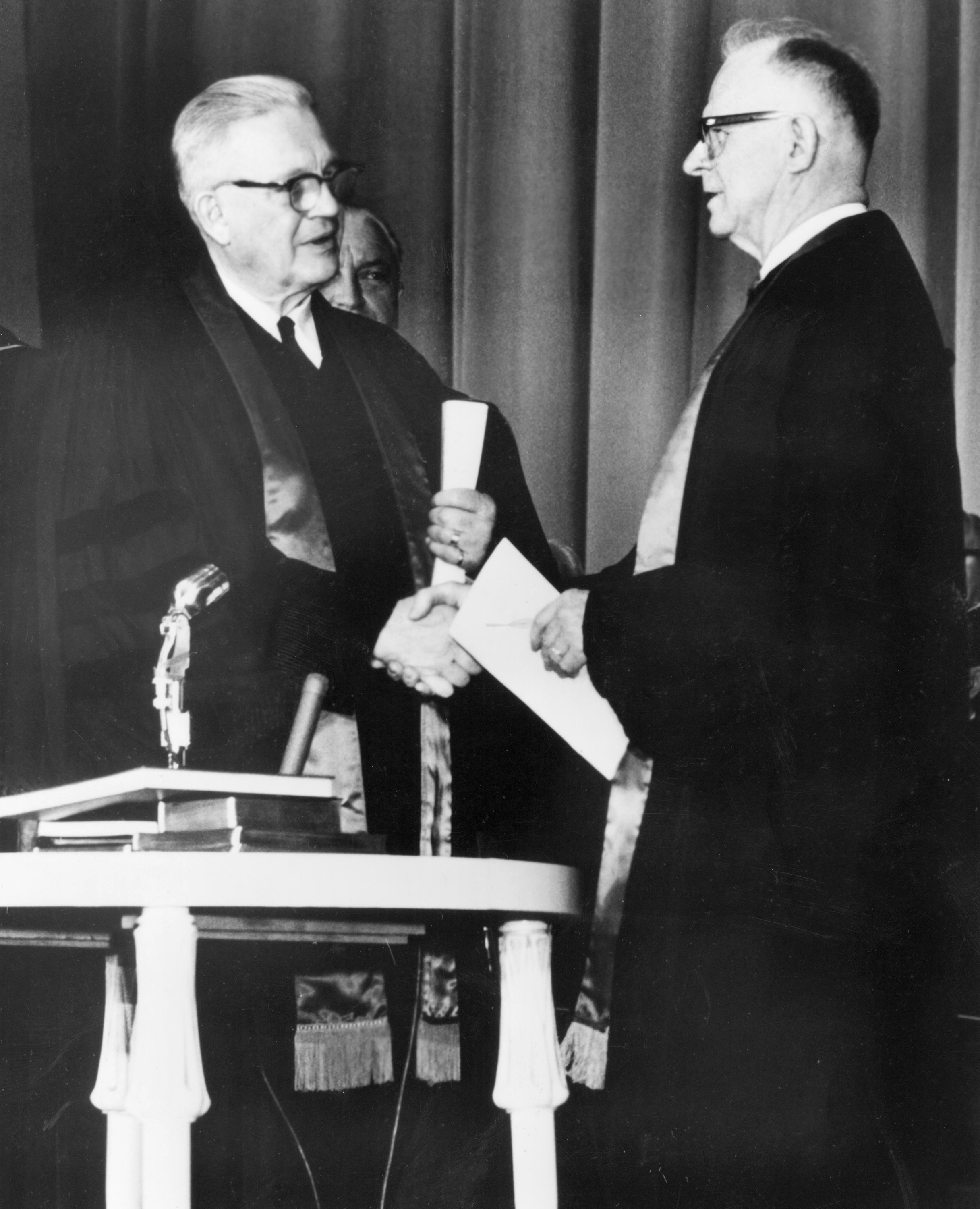 Evangelical United Brethren Church Bishop Reuben H. Mueller (left) and Methodist Bishop Lloyd C. Wicke join hands on April 23, 1968. Photo courtesy of the United Methodist Commission on Archives and History.