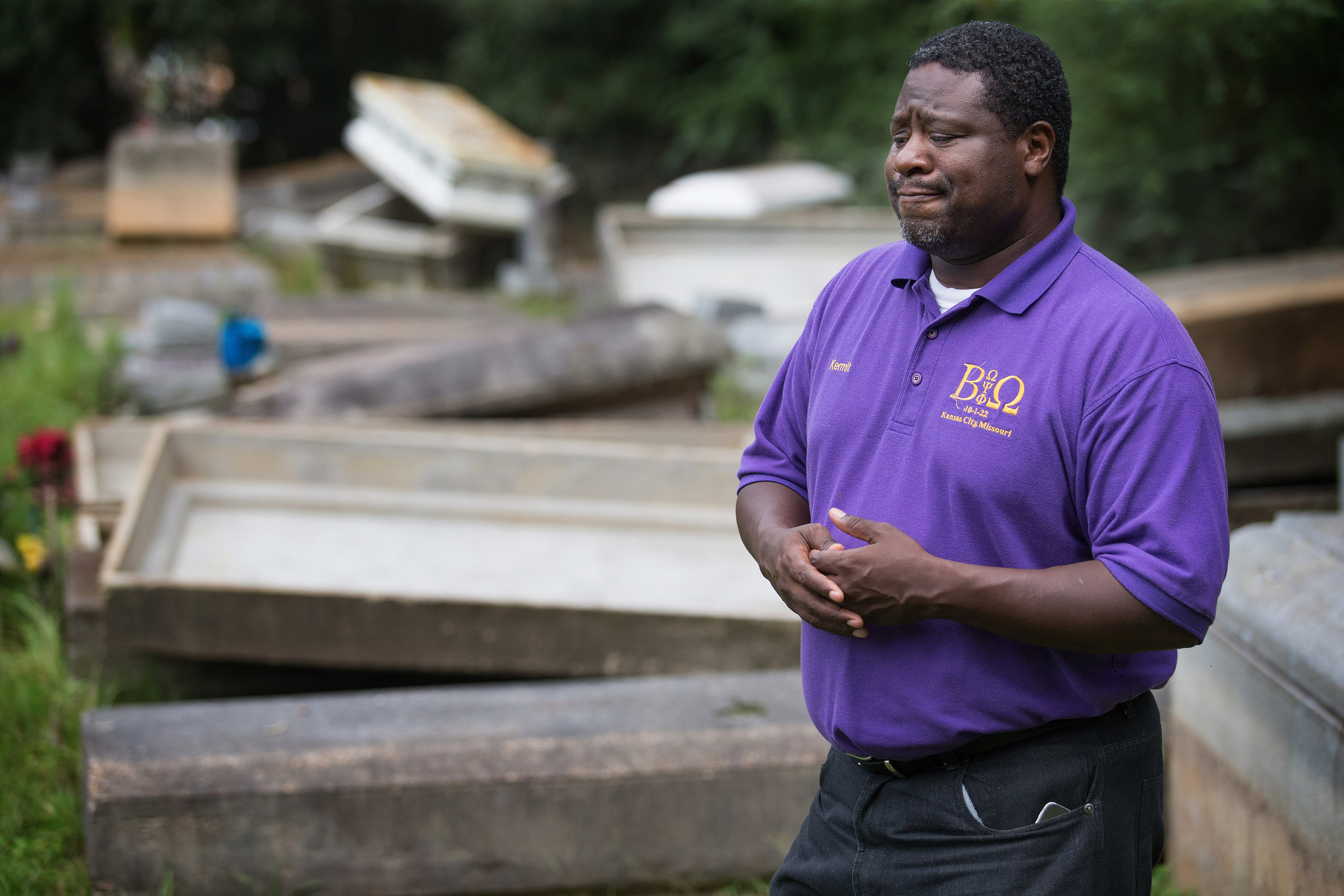 The Rev. Kermit Roberson surveys flood damage at Roberts United Methodist Church's Plainview Cemetery in Denham Springs, La., where floodwaters lifted many caskets out of their concrete burial vaults. Photo by Mike DuBose, UM News.