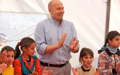 Francesco Paganini (center), UMCOR's International Disaster Response executive, with Syrian Children in a Child-Friendly Space at a refugee camp in Kilis, Turkey. The Child-Friendly Space is made possible by International Blue Crescent with funding from UMCOR.