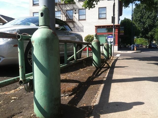 Sick fence in Portland made out of reclaimed welding tanks! #iNi #ReduceRecyleRepeat