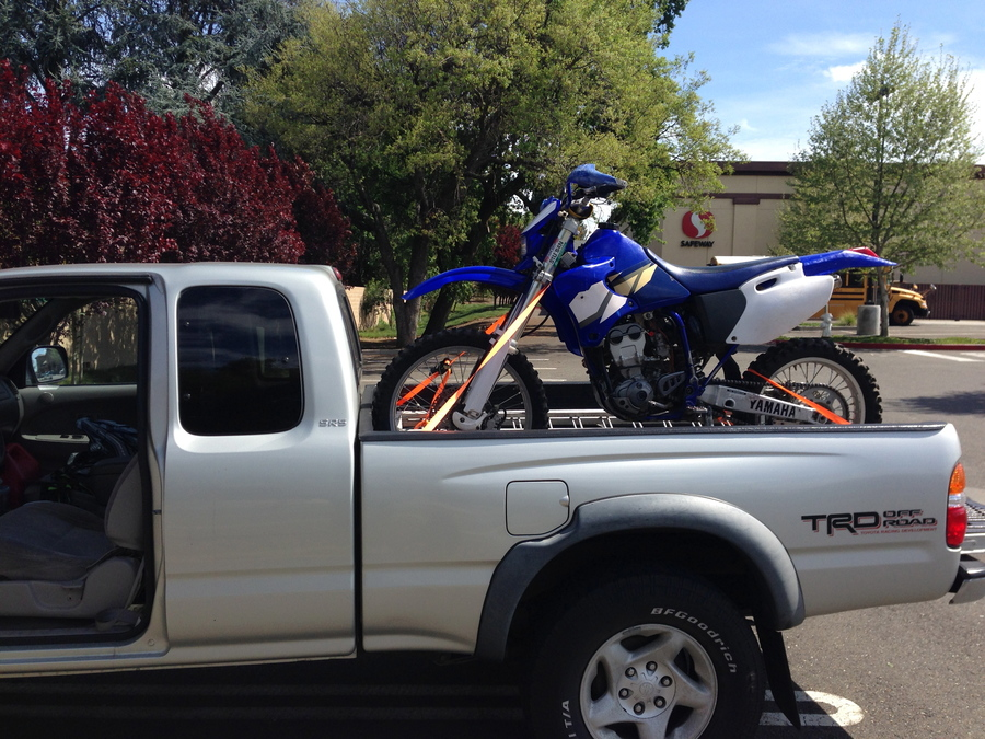 My new-to-me Yamaha WR250F.  $10 to the person who correctly guesses which bone I break first, haha.