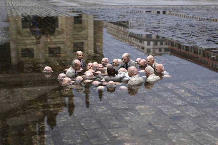 """This sculpture by Issac Cordal in Berlin is called ""Politicians discussing global warming."""
