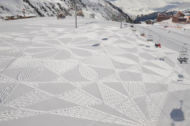 Amazing feat of the day: English artist Simon Beck creates stunningly large geometric patterns in the snow by walking miles in snow shoes.