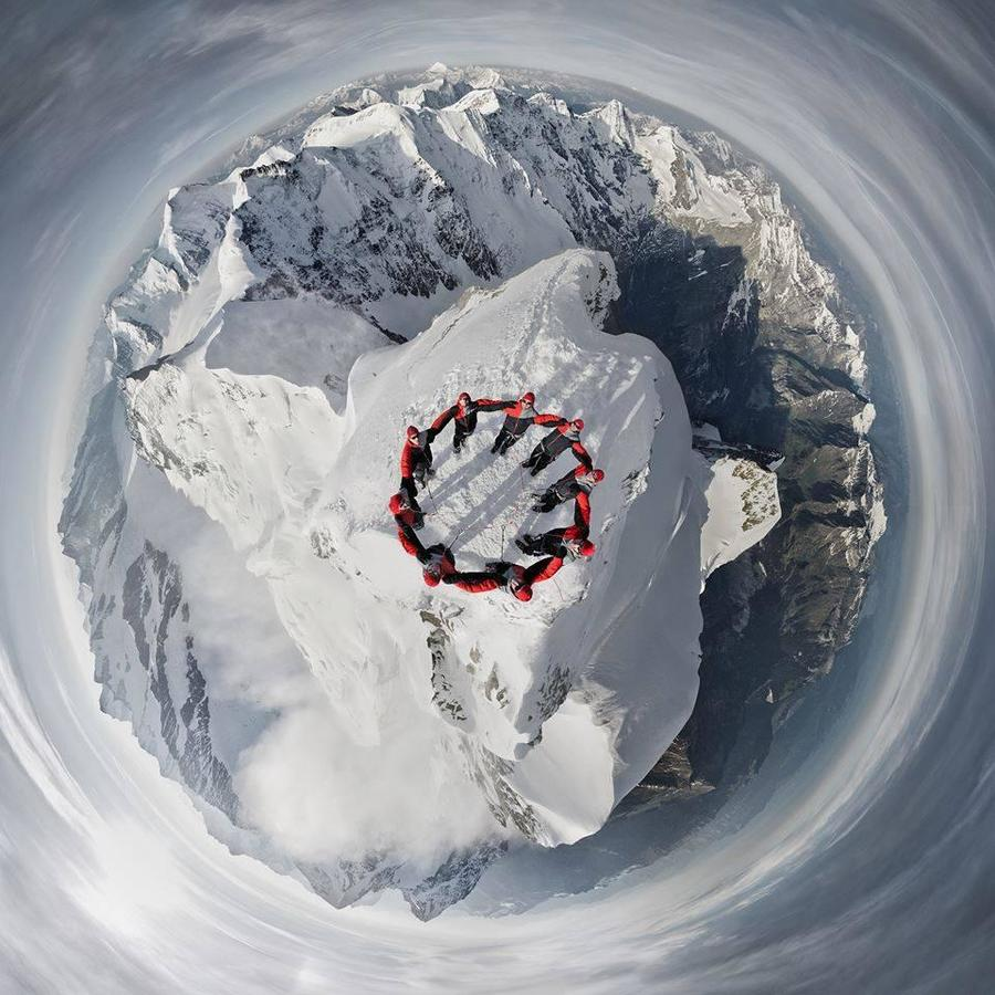 A photo taken by a drone of climbers at the summit of Matterhorn