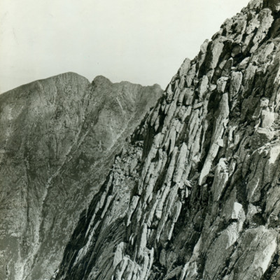"Eastern cliffs of Mt. Katadin. ""The Chinmey"" route L. background"