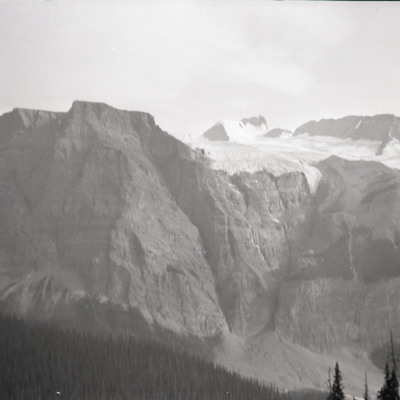 Mt. at corner of snowfield hanging glacier & hole of exit at [indecipherable] of cliff
