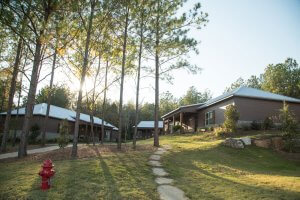 Cabins at Oxford Treatment Center are clustered on the west side of the lake.