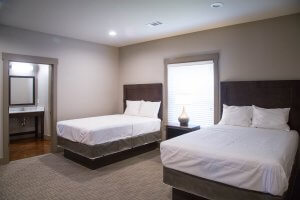 Each semi-private bedroom has its own adjoining full bath.