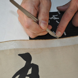 Minor repairs can often extend the life of an Asian painting