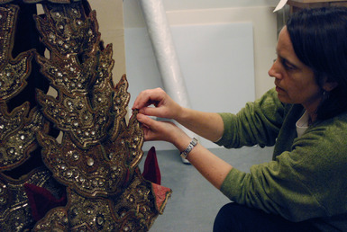 The complex structure hidden beneath this glittering dress is made from padded fabric-covered archival panels assembled by textile conservator Denise Migdail on a custom-built dress form