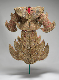 This Burmese court costume 200877A-J is made of fragile fabric encrusted with heavy metal and glass ornaments so the mount must provide plenty of support