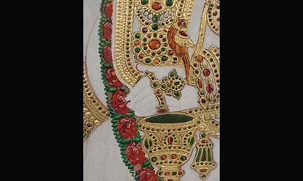 Detail showing low relief ornament with gilding colored glazes and black outline