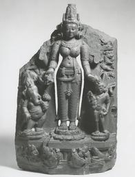 Black and white image of a sculpture of the Hindu deity Pavarti and her sons Ganesha and Skanda