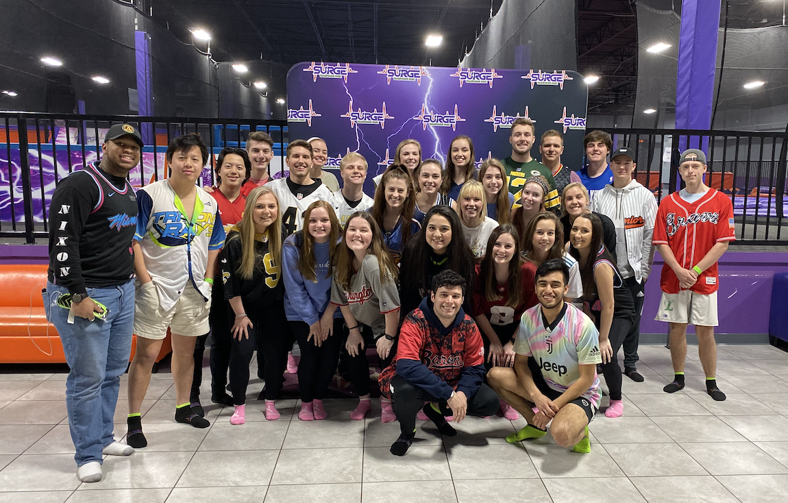 The members of Theta Chi and Alpha Xi at a trampoline park