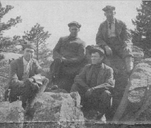men on a mountain