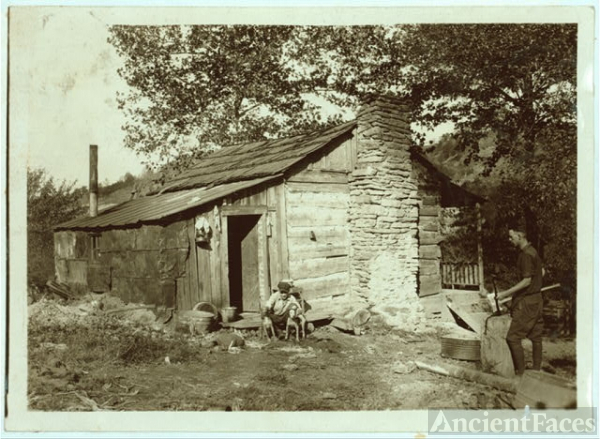 A little log cabin, - relic of the old days, - now...