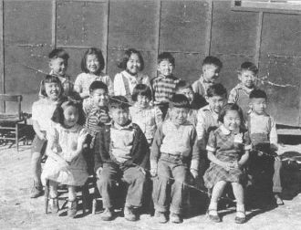 first grade students at war relocation center