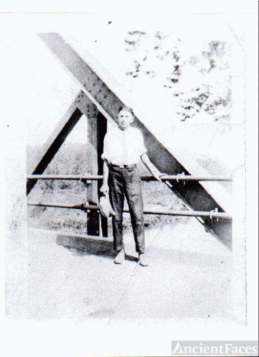 Young man on bridge