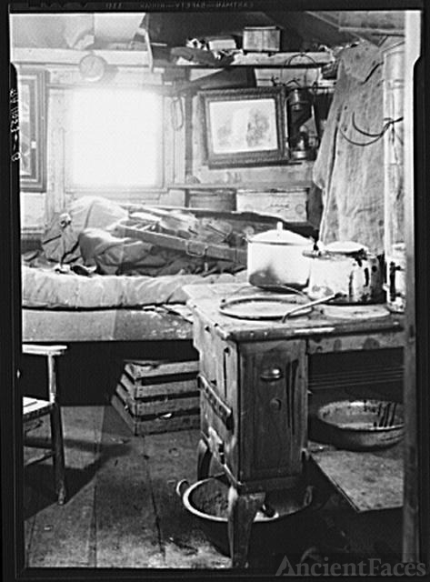 Ithaca, New York. Interior of a shack in which a man...