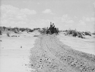 Leveling hummocks in dust bowl, thirty miles north of...