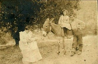 Family with daughter sitting on a mule