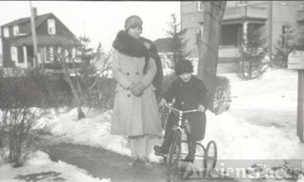 Woman and boy on bicycle