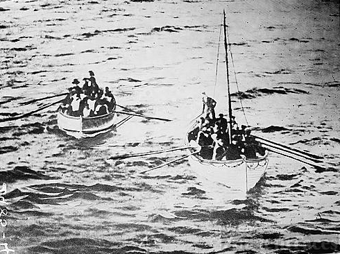 TITANIC lifeboats nearing the CARPATHIA