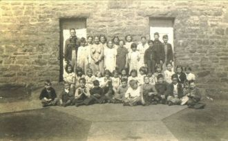 A photo of Back Row in Front of Teacher  Unknown